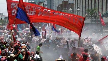 Протест против государственного визита президента США Барака Обамы в Филиппины 29 апреля 2014