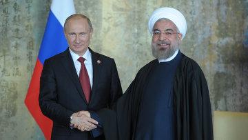 Президент России Владимир Путин (слева) и президент Исламской Республики Иран Хасан Рухани
