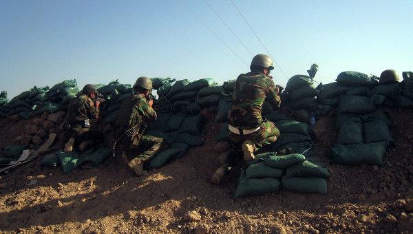 Курдские силы безопасности занимают позиции районе Таза, к югу от богатого нефтью города Киркук, Ирак. Архивное фото