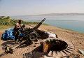 Член курдского вооруженного формирования возле города Мосул. 17 августа 2014