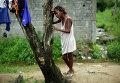 Девятилетняя жительница Монровии оплакивает свою мать, погибшую от лихорадки Эбола. 2 октября 2014 год
