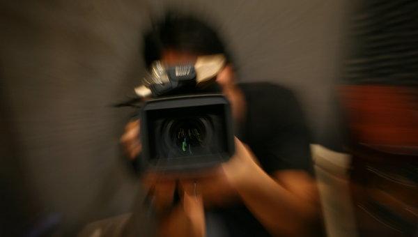 Репортер с камерой. Архивное фото