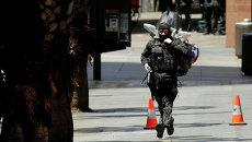 Полиция возле кафе в Сиднее, где неизвестный держит заложников