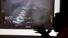 Фото с изображением фюзеляжа AirAsia, полученные с помощью подводной камеры