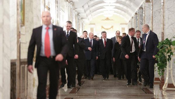 Президент Украины Петр Порошенко, канцлер Германии Ангела Меркель и президент Белоруссии Александр Лукашенко на встрече в Минске