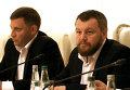 Вице-премьер Донецкой народной республики Андрей Пургин и Глава ДНР Александр Захарченко на переговорх в Минске