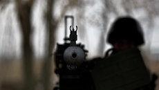 Солдат ВСУ с крупнокалиберным пулеметом.  Архивное фото