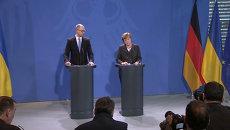 Яценюк и Меркель о соблюдении режима прекращения огня в Донбассе