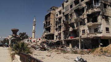 Разрушенный дом в лагере палестинских беженцев Ярмук на окраине Дамаска. Архивное фото