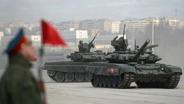 Танк Т-90А на полигоне в Алабино во время совместной тренировки пеших и механизированных колонн к Параду Победы