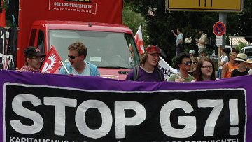 Акция протеста против саммита G-7. Архивное фото