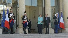 Олланд и Меркель подтвердили готовность ЕС продолжать переговоры с Грецией