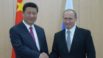 Президент Российской Федерации Владимир Путин и Председатель Китайской Народной Республики Си Цзиньпин. Архивное фото