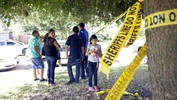На месте перестрелки, в которой были убиты восемь человек. Хьюстон, штат Техас, 9 августа 2015