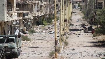 Главная улица сирийское города Забадани - линия фронта,  Архивное фото.