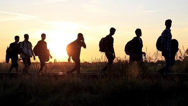 Сирийские мигранты после пересечения границы Венгрии и Сербии. Август 2015