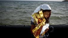 Мигрант на побережье. Архивное фото