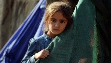 Девочка в лагере беженцев. Архивное фото