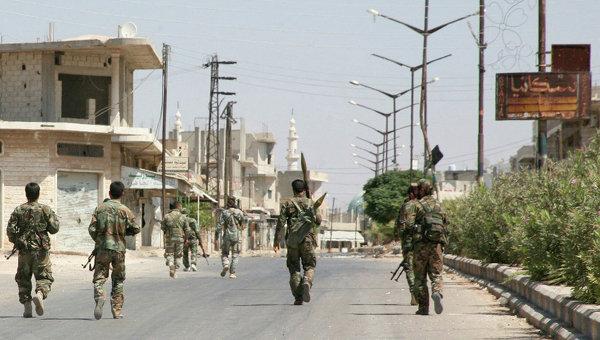 Солдаты сирийской армии в одной из деревень. Архивное фото