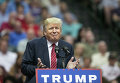 Кандидат в президенты США от республиканской партии Дональд Трамп во время предвыборного митинга в Далласе