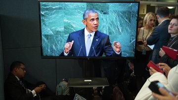 Журналисты слушают выступление президента США Барака Обамы