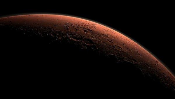 Смодулированное изображение поверхности Марса на границе между свтом и тенью в области кратера Гейл. Архивное фото