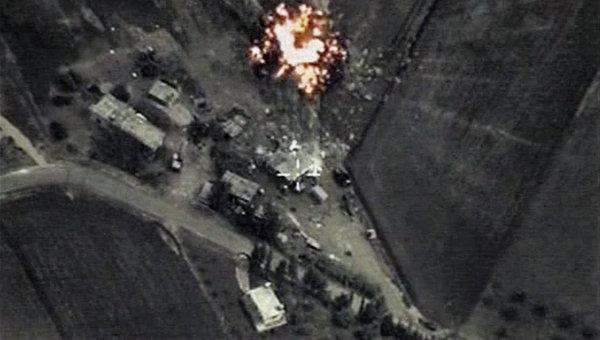 Точечные удары российской авиационной группы по объектам террористической организации ИГИЛ в Сирии. Максимально возможное качество. (Стоп-кадр с видео). Архивное фото