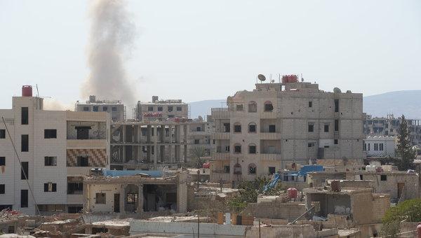 Дым от взрыва пригороде Дамаска Дарайе
