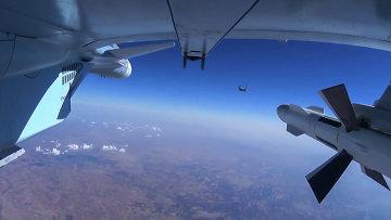 Самолет ВКС РФ во время боевого вылета в Сирии. Архивное фото