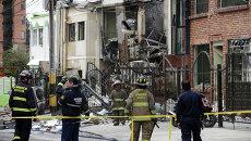 Пожарные на месте взрыва в здании фармацевтической компании в Боготе, Колумбия. 2 ноября 2015