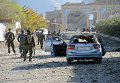 Сострудники служб безопасности на месте атаки талибов в провинции Кандагар, Афганистан. 19 ноября 2015