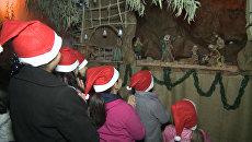 Молитва у вертепа и фото с Сантой – сирийские христиане отметили Рождество