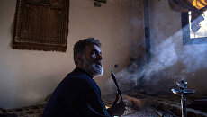 Беженец в районе Ярмук в Дамаске