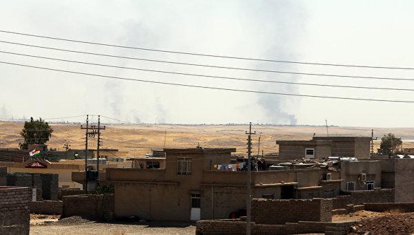 Дым над городом Мосул после ударов авиации США, Ирак. Архивное фото