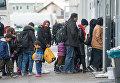 Беженцы в очереди на регистрацию в Пассау, Германия. 16 января 2016 года