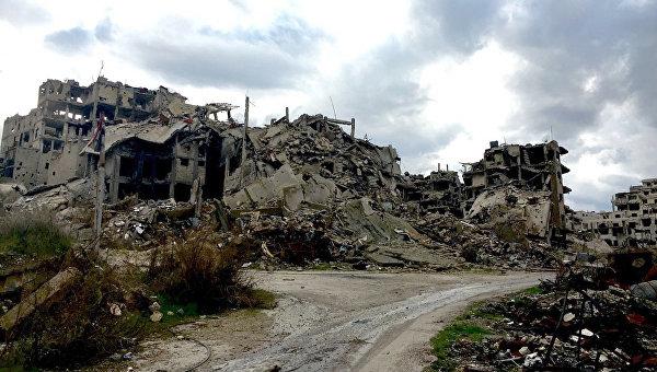 Разрушенные здания в Хомсе в Сирии
