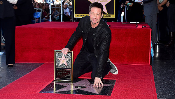 Дэвид Духовны с именной звездой на аллее славы в Голливуде