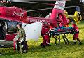 Спасатели погрузили в вертолет пострадавших при столкновении поездов в ФРГ