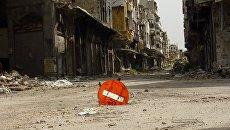 Разрушенные в результате боевых действий здания в Сирии. Архивное фото