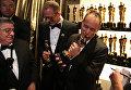 Пит Докте и Джонас Ривера с Оскаром за лучший анимационный фильм Головоломка на 88-й церемонии вручения премии Оскар