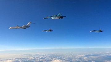Российские самолеты группами вылетали с сирийской авиабазы в РФ