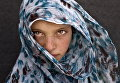9-летняя сирийская беженка в лагере в окрестностях города Эль-Мафрак, Иордания