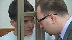 Надежда Савченко и ее адвокат Николай Полозов во время вынесения приговора в суде . 21 марта 2016
