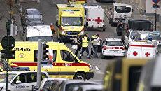 Службы спасения на месте взрыва в метрополитене Брюсселя. 22 марта 2016