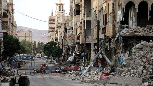 Разрушенные дома на одной из улиц Пальмиры. Архивное фото