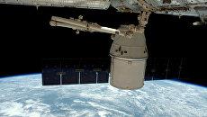 Отстыковка космического грузовика Dragon от МКС. Архивное фото