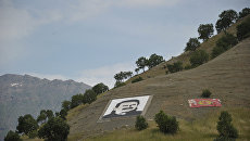 Портрет Оджалана и флаг РПК в горах Кандиль. Архивное фото