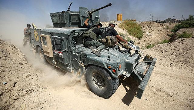 Иракские правительственные войска во время операции против ИГИЛ*. Архивное фото