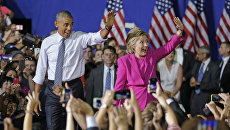 Хиллари Клинтон и Барак Обама на предвыборном митинге в городе Шарлотт