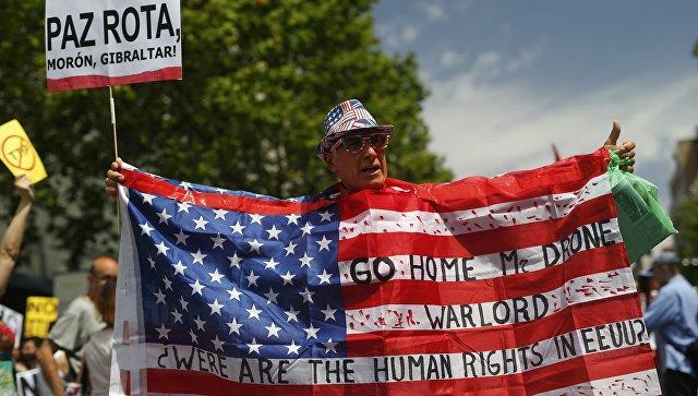 ВМадриде упосольства США прошла акция против приезда Обамы